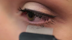 Combing eyebrows in a beauty salon - stock footage