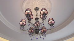 Beautiful crystal chandelier on the ceiling. - stock footage