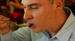 Man eating soup in a restaurant close up - stock footage