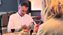 Couple having lunch in a restaurant Arkistovideo