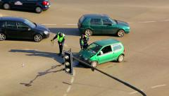 Traffic police officers investigate a road traffic accident Stock Footage