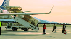 Passengers exit the plane at the airport rg Stock Footage