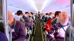 Interior of airplane in fly with passengers on seat rg - stock footage