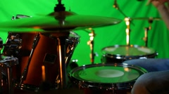 Drummer plays drums isolated on green Stock Footage