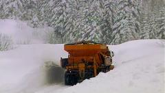 Big machine cleans a heavy snow from the roads - stock footage