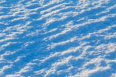 abstract snow background at sunset lights - stock photo