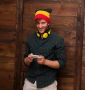 Hipster man with mobile phone over wooden - stock photo