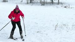 All Winter Magic-A Young Woman is Skiing on a Beautiful Mountain in Slow Motion - stock footage