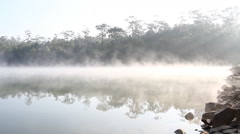 fog on lake morning and sunrise in spring - stock footage