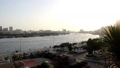 Sunny middle east evening over Dubai Creek, desaturated colours, bright sky Stock Footage