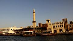 Grand Mosque at Bur Dubai district, as seen from boat move along harbour Stock Footage
