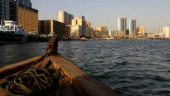 Front view, sail on wood dhow boat, traditional Abra ferry at Dubai Creek Stock Footage