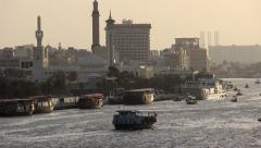 Dubai Creek telephoto view, Bur Dubai Grand Masjid and Farooq Mosque minarets Stock Footage