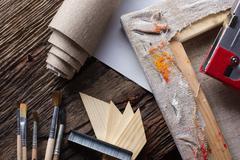 Set of brushes for painting, canvas, stapler, staples, subframe - stock photo