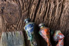 Vintage stylized photo of oil multicolor paint tubes closeup and Stock Photos