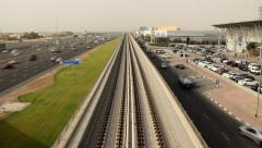 Empty overground metro railway, red line flyover beside busy Sheikh Zayed road. Stock Footage