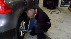 Changing the tires on an automobile Stock Footage
