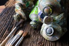 Vintage stylized photo of oil multicolor paint tubes closeup and - stock photo