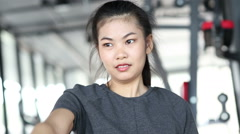 Young sports woman doing exercises with dumbbells in the gym. - stock footage