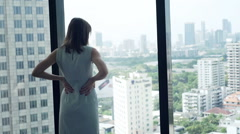 Young businesswoman admire view from window in office Stock Footage