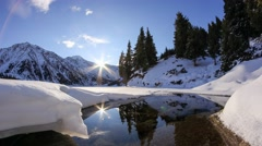 Sun rise on the Big Almaty lake in mountains of Kazakhstan Stock Footage