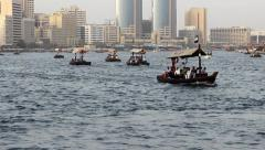 Small wood Abra boats on water, traditional ferry transport at Dubai Creek Stock Footage