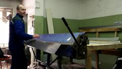 Tinsmith works with bending machine for sheet steel decorative products Stock Footage