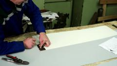 Tinsmith creates a new design of metal products for the construction house Stock Footage