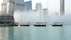 Pleasute boats with people observe music fountain, stand in line against water Stock Footage