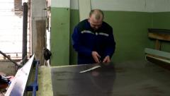 Tinsmith scissors metal sheet makes the markup for bending new item Stock Footage