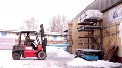 Forklift lifts the load on a special platform in the winter on snow Stock Footage