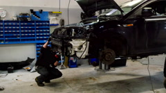 Mechanics are repairing a car Stock Footage