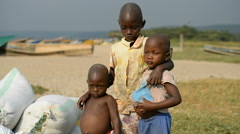 Portrait of local children on the lake Edouard in the Kisenyi, Uganda. Stock Footage
