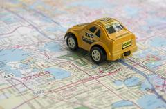 traveling in automobile by using paper map - stock photo