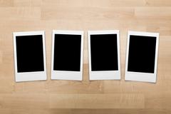 Stock Photo of Portrait format instant film photo sizes on wood