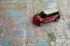 Traveling in automobile by using paper map Stock Photos
