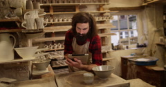 4K Portrait of smiling small business owner in pottery workshop Stock Footage
