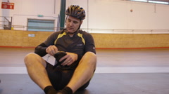 4K 2 Competitive cyclists, 1 with prosthetic leg, prepare for training session Stock Footage