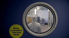 A woman in a lab coat is coming into a secret Russian laboratory - stock footage