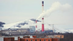 Smoke from pipe of thermal power station in winter - stock footage