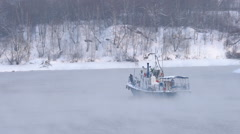 Industrial boat in the winter, sailing in the fog Stock Footage