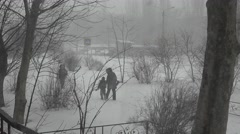 People and Cars driving on snow-covered street,  in bad stormy weather Stock Footage