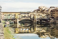 Ponte Vecchio is mirrored in the river Arno, Florence, Tuscany, Italy. Travel Stock Photos
