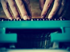 man typewriting, filtered - stock photo