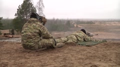 Snipers   shoot a .50 caliber sniper rifle Stock Footage