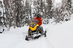 Athlete on a snowmobile. - stock photo