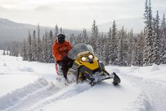 Athlete on a snowmobile. Stock Photos