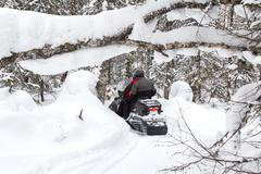 Athletes on a snowmobile - stock photo
