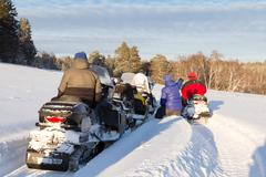 Stock Photo of Athletes on a snowmobile