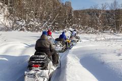 Athletes on a snowmobile - stock photo